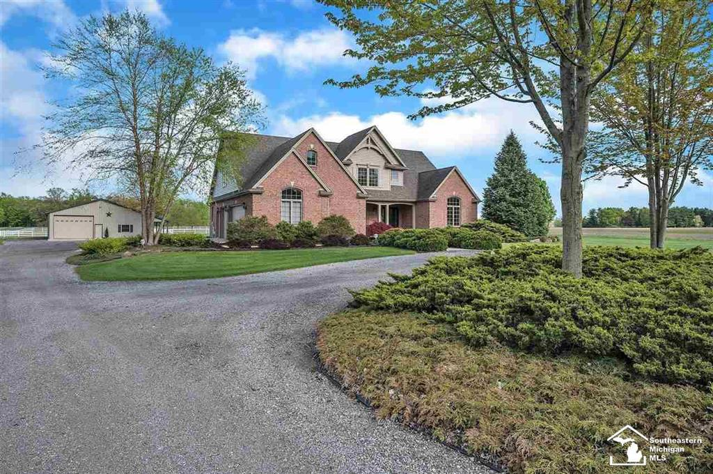 """Extraordinary Homestead on nearly 12 ACRES of manicured perfection zoned Agricultural!  Every detail of this Estate has been thought-out and executed. The custom built 3-4 bedroom, 3000+ square foot home has an Owner's suite and laundry center on the main floor. The 3+ car finished attached garage has access to the full basement; 42' x 76' pole barn and 42' x 16' covered patio and SO MUCH more!   There is something to make everyone happy here! Beautiful home, a mechanic's dream; a collector's gallery or an animal lovers paradise. The rear section of the barn has two horse stalls; tack room & hay loft plus two pastures. ALL the city conveniences and spectacular views of your """"country living"""" location. Easy access to I-75 and 275.  Inquire about a detailed list of some of the MANY extras and make your private viewing appointment to explore this unique home!"""