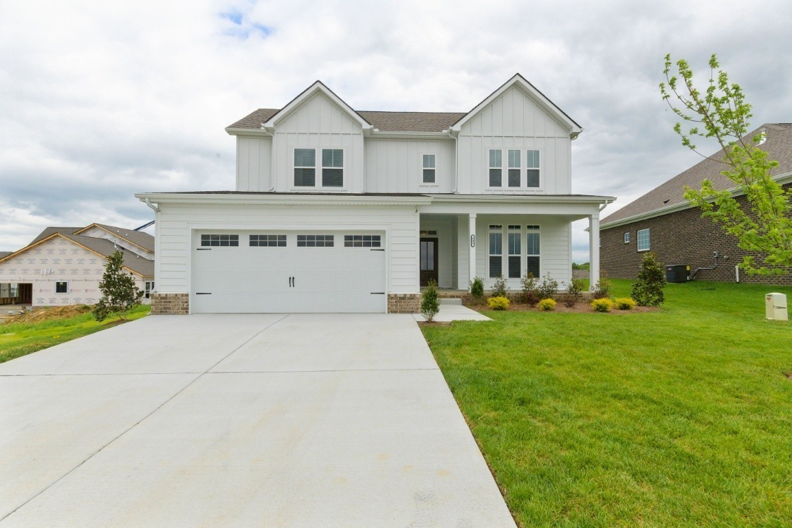 """Regent Homes """"Oxford Farmhouse"""". Open concept living with the master bedroom on the first floor. 4 BR, 2.5 BA, hardwood in most common areas, tile in all baths, granite countertops and stainless appliances included. Home will be completed by 10/1/2021"""