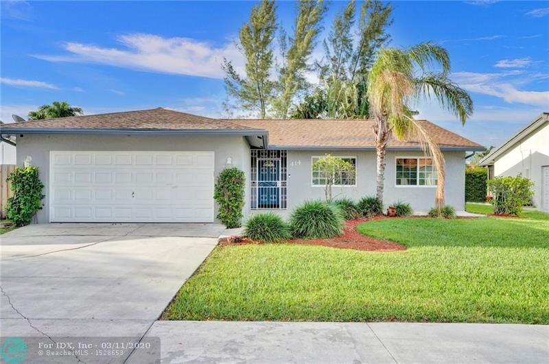 What a great house within a 13 min bike ride to the sandy shores Of Dania Beach.  This is a large 4/2 with a 2 car garage.  IMPACTS WINDOWS ! Boasts over 1700 sq ft and a Private screen porch in the back.  Fully fenced.  Wood-look tile floors run on the angle, throughout the living spaces.  Kitchen has been upgraded and is wide open to the living spaces.  This house has a great flow to it.  Good size bedrooms.  Located on a tree lined street with sidewalks.  8 min walk to the casino