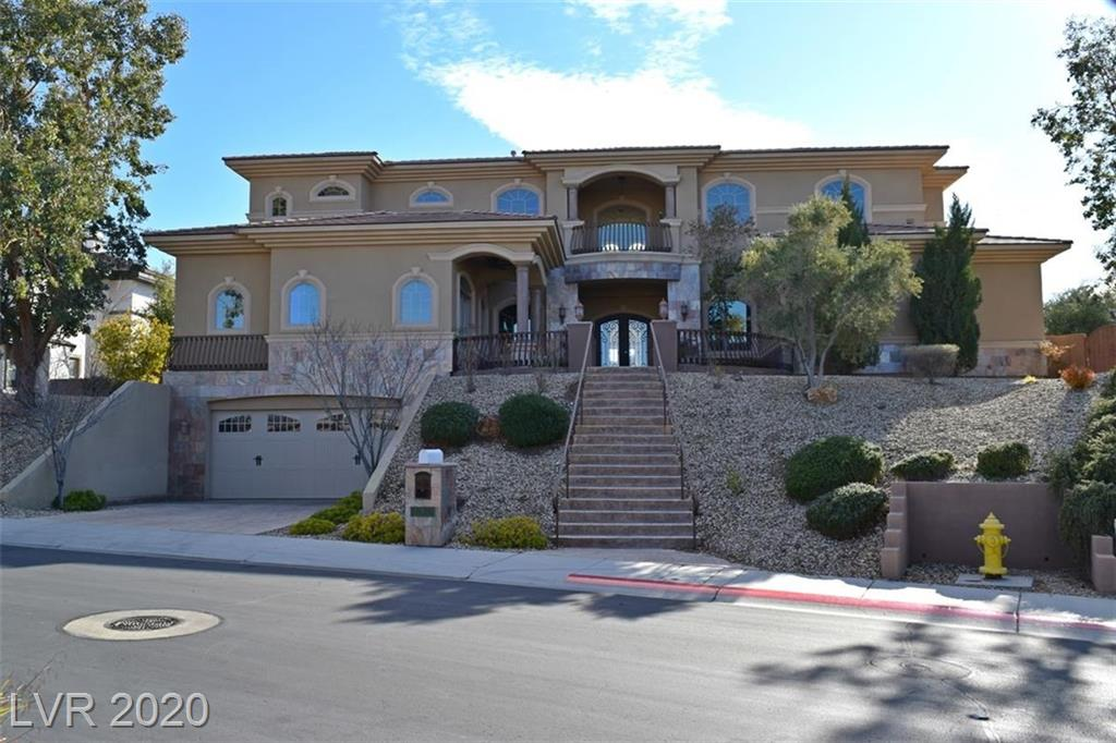 Gorgeous Anthem home with Mountain, Strip and Golf Course views! Elevated home on the 16th hole. Elevator, 2 Master Bedrooms (1 upstairs and 1 down) Each bedroom with its own private bath. 4 fireplaces. Marble and granite throughout. Stunning pool with swim up BBQ/Bar. Basement with wine cellar. View today!