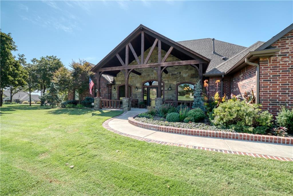 Located in the gentle rolling hills of East Edmond in the highly desirable 73034 zip code & Edmond Schools, just east of I35 shopping & town, this incredible home has the mountain vibe right here in central OK!  With over 4100 sq ft, custom wood builtins everywhere, open kitchen/floorplan, gas cooktop, formal dining, formal living, huge pantry with builtins,  4 spacious bedrooms, 2 full bath, 1 three quarter bath, 2 half baths, study with built in book case/desk, wood burning fireplace in the majestic living area, sunroom, large covered patio, upstairs bonus, fenced area for pets, master ensuite with gas burning fireplace, large master bath and his/her master closet with more builtins! Spray foam insulation for extremely low utility bills! Extra large 3 car garage and a HUGE 50x30 insulated workshop with geothermal HVAC, 12'9'' overhead door.  So much more to see in person, let's get that showing scheduled soon!