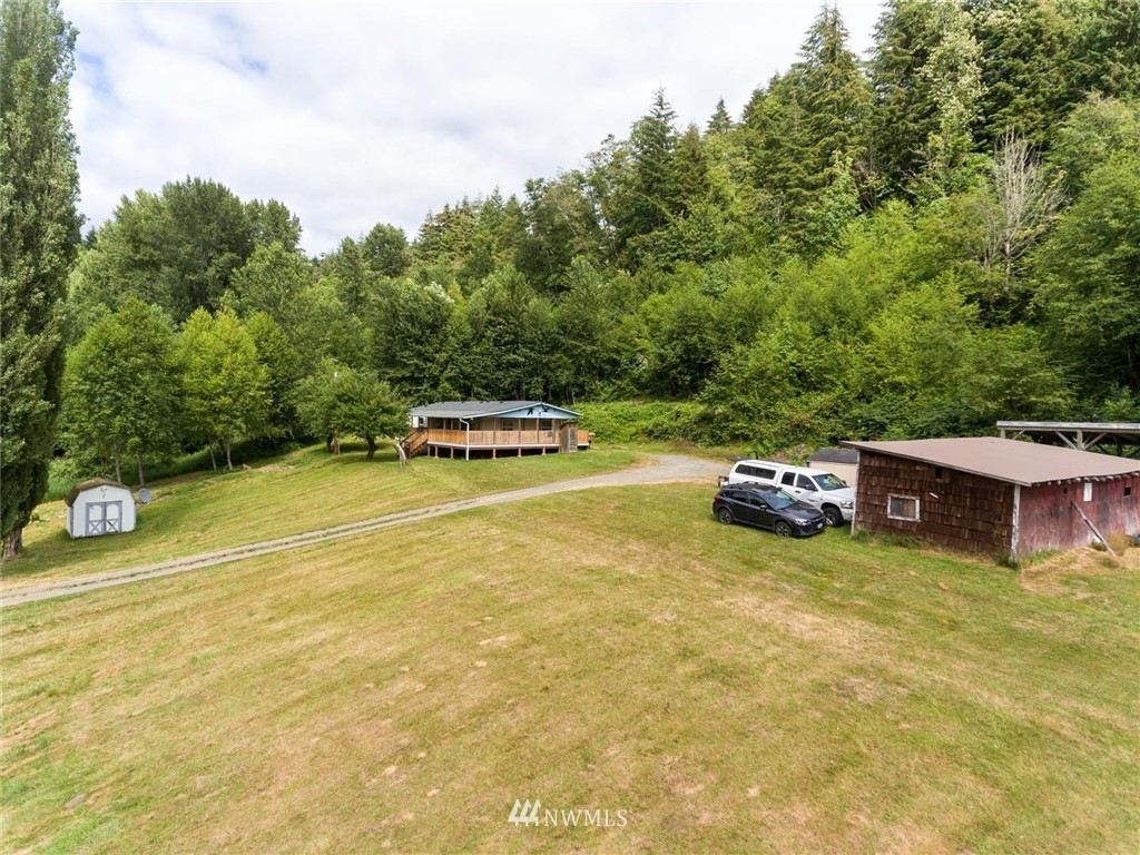 Beautiful setting, 5.13 acres located on secluded Meade Hill Rd in Glenoma. Gentle slopes help create wonderful views of this excellent property. Huge wrap around deck to enjoy the views. Brand new roof replaced as a preventative measure, not out of necessity. 16'x36' carport, (2) 10'x12' sheds, 14'x30' RV carport, and a 16'x24' shop are on the property as well. Plenty of room for all of your toys.