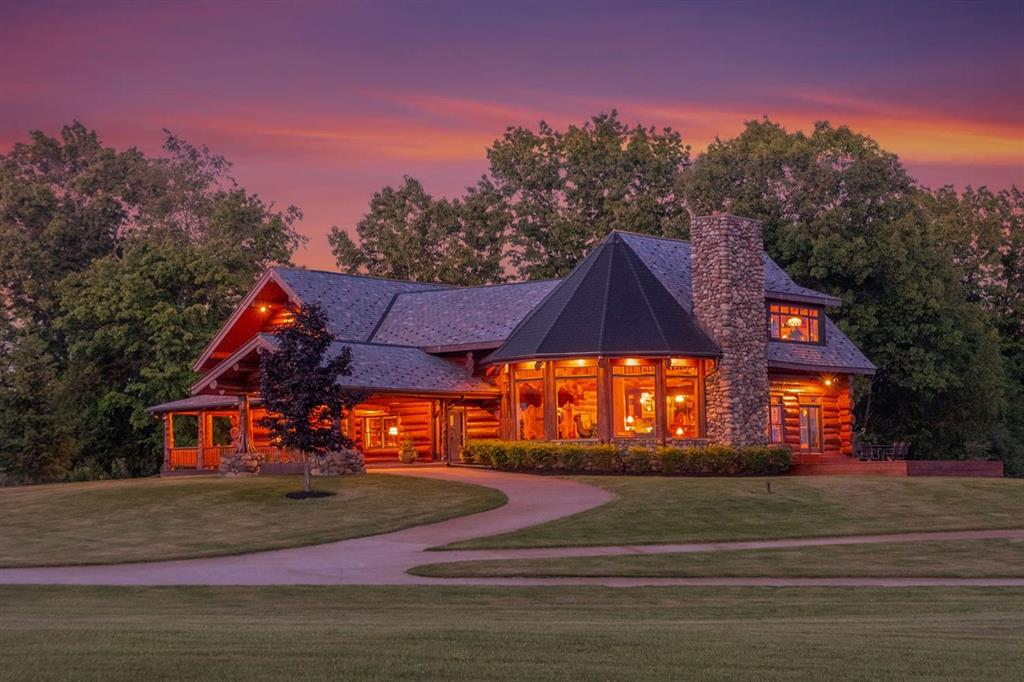 Breathtaking, glorious and exquisite are the first words that come to mind when describing this custom designed & built North Arrow Log Home! Featuring 5,293 square feet above grade, this palatial wonder boasts 5 bedrooms, 4.5 bathrooms sitting high on a hill with 110 of the most beautiful acres of rolling meadows & hardwood forests, a meandering stream & panoramic views from every window without a single home in sight as far as the eye can see. Upon entry, you'll immediately notice the excellence in craftsmanship, attention to detail w/elegant finishes, walnut flooring, soaring ceilings w/copper accents throughout this amazing home, 20' fieldstone fireplace in the living room, a true gourmet/Chefs kitchen boasting Sub Zero & Wolf appliances, formal dining room, expansive master suite w/finest of finishes, library/office, professionally finished walkout basement, main floor laundry, geothermal heating system, 38kW whole house generator & 20kW solar array. The professional outbuilding i