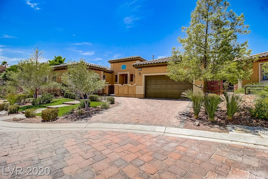 Look no further! Gorgeous single-story home in gated Lake Las Vegas community. Immaculate condition. Highly upgraded with travertine floors, espresso cabinetry, granite counters, and stainless-steel appliances, including a professional-grade cooktop and micro/oven. Spacious owner's suite with spa-inspired tub, oversized shower, and custom walk-in closet. Large private den/office, in-ceiling speakers, and multiple areas for entertaining. Enjoy the gated courtyard entry, interior courtyard with louvered patio cover, and pool-sized backyard with covered patio, modern gas fire pit and built-in barbeque with gas grill. Minutes from Lake Mead and the Las Vegas Strip, plus all the amenities within Lake Las Vegas such as pools, fitness center, tennis and pickleball courts, award-winning golf course, miles of biking and hiking trails, and a lakeside village with grocery store, multiple restaurants, and other amenities. Buyer receives a Lake Las Vegas Sports Club Membership valued at $10,000!