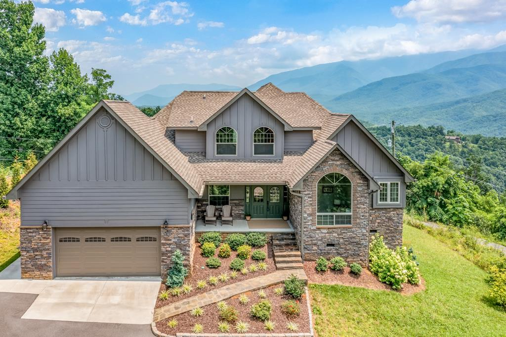 The Captivating View from this luxurious 3BR, 2.5BA Smoky Mountain home extends from Mt. LeConte to Mt. Cammerer and beyond. New in 2018, it is in Impeccable condition throughout! Gorgeous vaulted ceiling with walls of windows for your enjoyment of those views. Tastefully decorated, and it comes fully furnished. Open concept living makes it easy to entertain several guests. Upscale kitchen design features granite counter tops and custom cabinetry. Lovely & spacious master suite is located on the main level. Upstairs are the second and third bedrooms. This magnificent home also features a private Den with pull-out sofa bed that could also be used as an office. The two car, attached garage is equipped with a handicap ramp.Beautiful landscaped all around home. Perfect for primary residence, vacation home or overnight rental.  Currently the loft area is used as an office but could be used as a game area. Overnight rental projection is $102,269.00 yr.