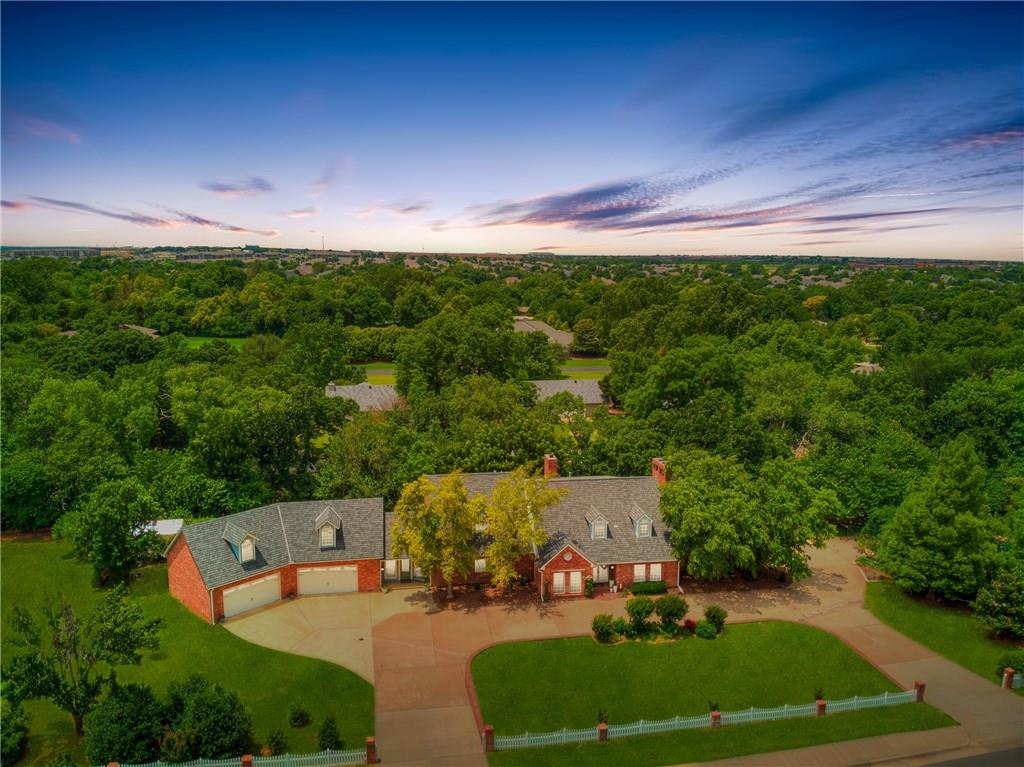 Are you looking for a home situated almost two acres complete with a stunning pool, incredible landscape, large deck, greenhouse, 6 car garage, quality craftsmanship and attention to detail throughout? If so, you have found it in this south Edmond property located 1 minute from the Kilpatrick Turnpike in Northwestern Estates. The two-story entry flows seamlessly into the custom paneled study and formal dining. A butler's pantry opens to the Kitchen featuring soaring ceilings, skylights and commercial appliances. The adjacent breakfast room has amazing backyard views and custom cabinetry. Steps from the kitchen is a large family room with a wall of windows, a beautiful fireplace and surround sound. The Master Suite boasts a large seating area and on suite bathroom which was remodeled in 2015. In 2016 a 4-car garage, mud room, laundry room and studio space was added to the south end of the home. Upstairs you will find three large guest rooms and a theatre room. Priced to sell!