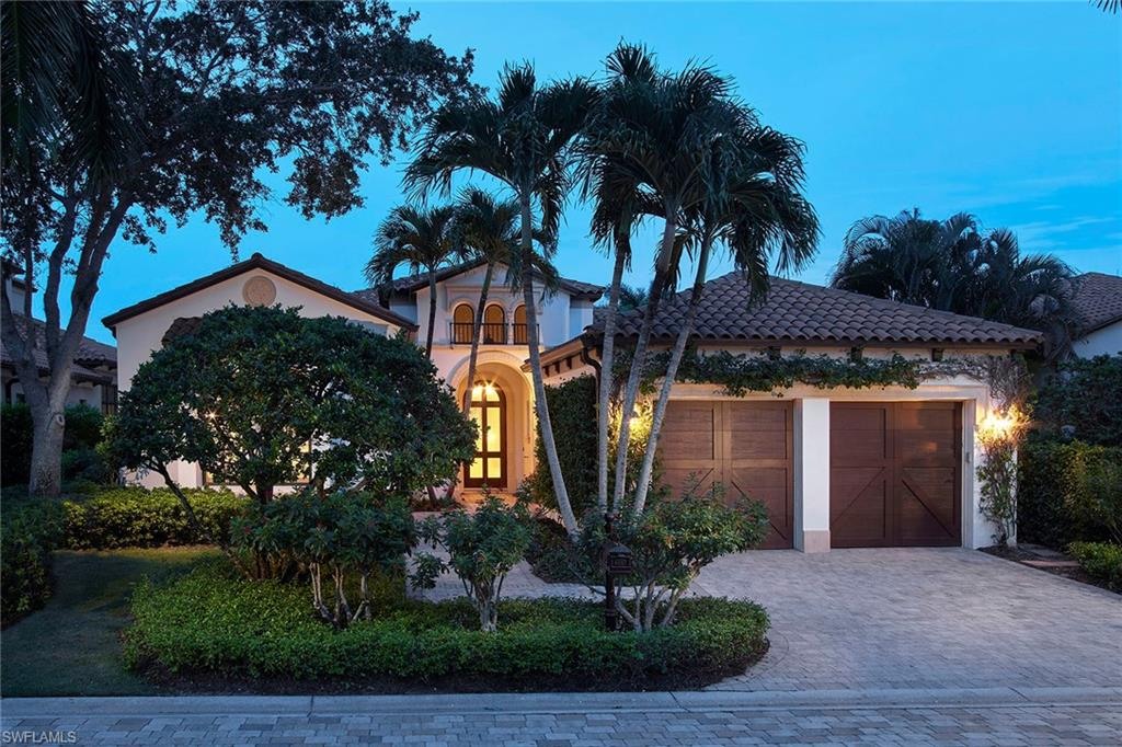 This bright and airy open-concept villa is highly upgraded and resides in the exclusive Marsh Wren neighborhood in Estuary at Grey Oaks. The over 3,700 square feet of living space includes four bedrooms and four and a half baths. The neutral stone flooring, Wolf/Sub-Zero appliances and large sliders in the great room and owner's suite are just a few of the upscale features of this villa overlooking the 18th green and majestic clubhouse beyond. The outdoor living area is perfect for entertaining and includes a gas fireplace, outdoor kitchen with gas grill, pool and spa. Additional features include impact-resistant windows and doors throughout, a Lutron lighting system, a two-and-a-half-car garage and a majestic mahogany front door with glass inserts. A world of luxury awaits you in the lavishly updated Grey Oaks Country Club community.