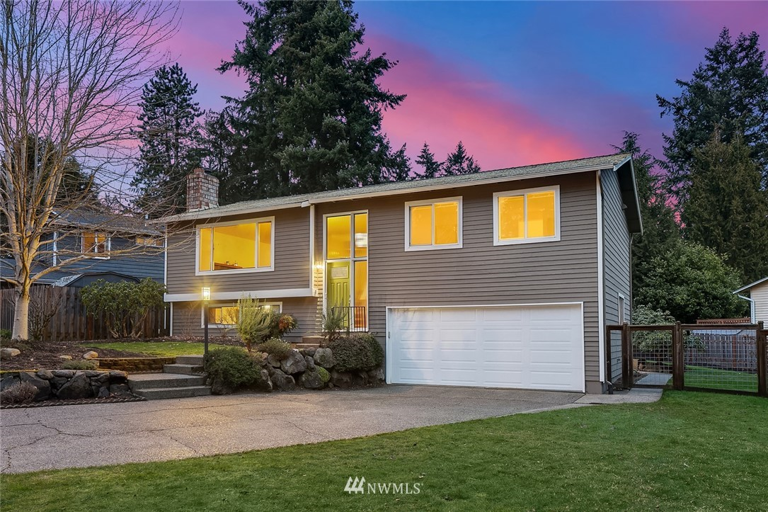 Enjoy living comfortably in this lovely, updated Kirkland 3-bed, 2.25 (full, 3/4 & 1/2) bath home on gorgeous corner lot with mature landscaping. Spacious layout, large covered deck & patio space allow year-round entertaining. Kitchen with SS appliances. Large, sunny, fully-fenced back yard makes for a gardener's delight or great play yard. Large, attached 2-car garage. Newer furnace with AC and hot water tank. Gorgeous remodeled baths with Marmoleum flooring. Wired for generator. Awesome schools, minutes to 405, yet still in a quiet Finn Hill neighborhood setting. Easy commute to Eastside or Seattle. Fantastic nearby parks, excellent shopping, services, medical & close to future Google location(s). In fantastic condition & pre-inspected.