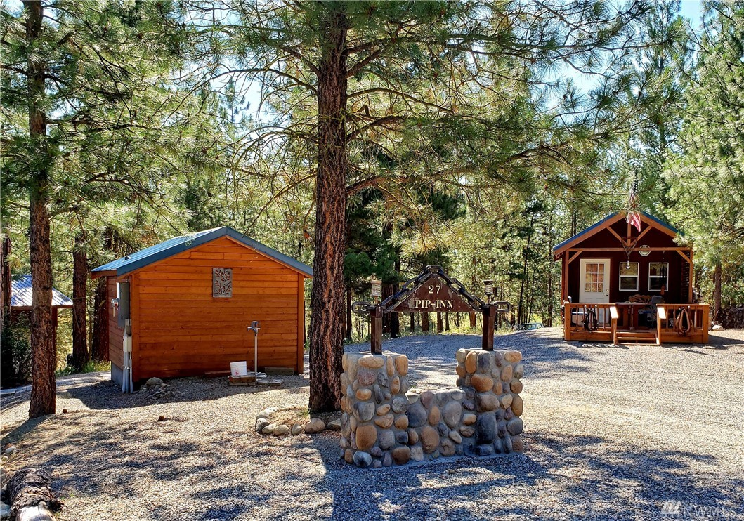 Very  nice Winthrop vacation cabin. Full acre lot in the Twin Lakes Community. The cabin sleeps 4 with loft. 24 x 30 garage, 12 x 40 RV covered slip with a large RV included in sale. Property has a 4 bedroom septic and a drilled well. The community has a swimming pool and club house.
