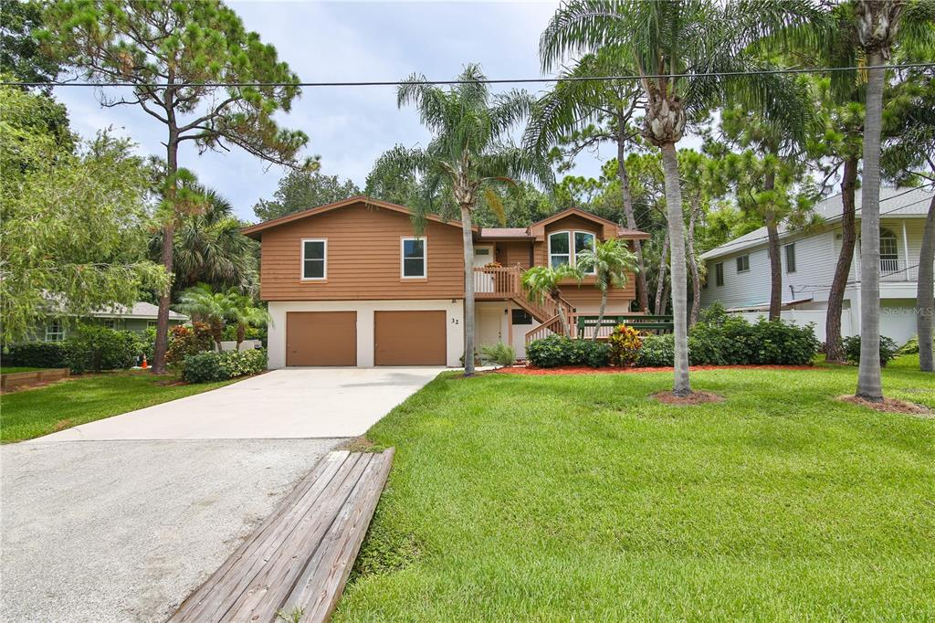 Stunning home in an excellent location WEST OF THE TRAIL!! Located less than 1 mile to Oscar Sherer Park and less than 20 minutes to both Siesta Key and Nokomis Beach. Beautifully designed three bedroom two bathroom home with over 2200 sq ft to roam! Brand new hurricane impact windows were just installed (25k!). Enjoy a brand new kitchen boasting stone counter tops, easy catch cabinets and lots of natural light. Relax in the comfort of a spacious master suite equipped with en suite. FANTASTIC possibilities downstairs as a half bath and closet already exist! This is a perfect opportunity to turn the space (approximately 500 sq ft) into a mother in-law suite, game room, or private guest quarters. Tons of untapped potential in this west of the trail, 2256 sq ft home! Also, plenty of room to add a pool in the peaceful and private back yard. The potential of this home is endless and waiting for you to make it your slice of paradise today! It won't last long!