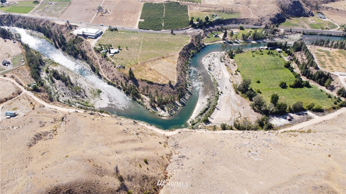 Don't miss this awesome opportunity to own over 17 acres overlooking the Methow River! Close to the Columbia River, Pateros and Twisp. Great recreation or build your dream cabin and live year round. Power already on lot, ready for you to bring your plans. Gated community has riverside cabana with BBQ area, restrooms and showers. A must see!!