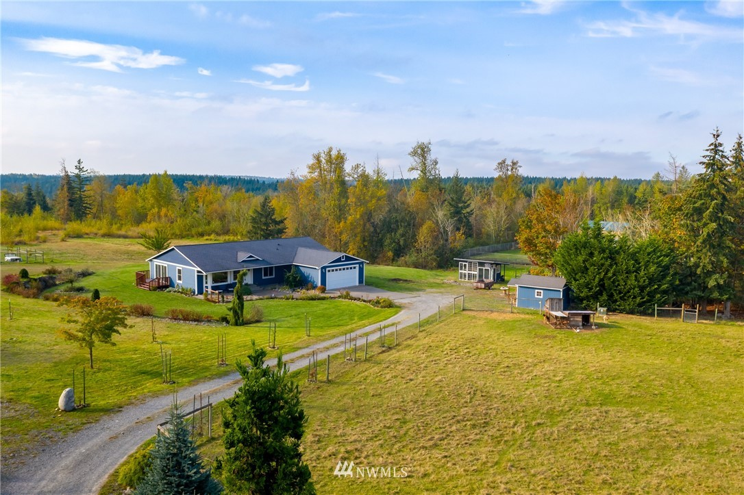 Extraordinary Mountain View Rambler on 20 Acres! New Chef's Kitchen; Hickory floors, cabinets, fixtures, large island, stainless steel appliances, double oven. Master Bdrm Suite; new Master Bath & tile floors. 2 more large bdrms + den & new full bath. 2 car attchd + 1 car det. Heat Pump/AC. 3 fenced pastures. Small animal sheds. Gardens, raised beds, fruit trees. Kreger Lake Estates, gated community. Bridle trails, ride to Nisqually River. Adjoins forest land. Mt. Rainier, Olympics, Bald Hills.