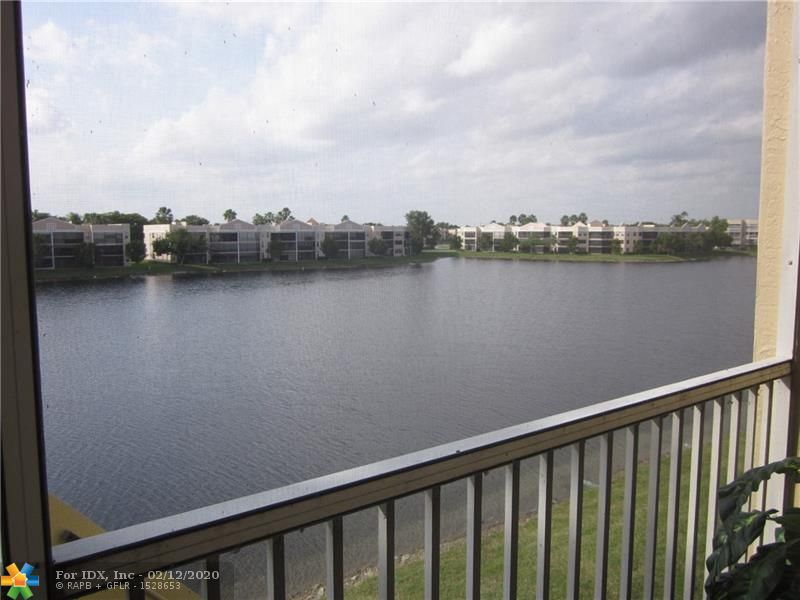 HURRICANE WINDOWS AND SLIDING DOORS SURROUND THIS CONDO WHICH FEATURES-FANTASTIC WATER VIEW FROM PATIO.FANTASTIC PARKING SPACE,FANTASTIC PRICE. ALL TILED EXCEPT BEDROOMS. GRANITE COUNTERS IN KITCHEN.TWO HUGE WALK-IN CLOSETS PLUS A SECOND CLOSET IN MASTER BR.NEWER AC.CLUBHOUSE DEED IS PAID IN FULL FOR LOWER MAINTENANCE.DECORATOR TOUCHES THROUGHOUT.MAGNIFICENT WALL UNIT IN SECOND BEDROOM STAYS. (YOU ARE WELCOME) ALARM,CABLE AND INTERNET INCLUDED IN MAINTENANCE.ALL KINGS POINT AMENITIES INCLUDING TRANSPORTATION, CLUBS, CLASSES, SEMINARS, EXERCISE CLASSES,WEIGHTS,TREADMILLS, BIKES,CERAMICS,PAINTING DANCES,FABULOUS SHOWS IN THE 1000 SEAT STATE OF THE ART THEATER AND ALWAYS SOMETHING TO DO AND SOMEONE TO DO IT WITH.
