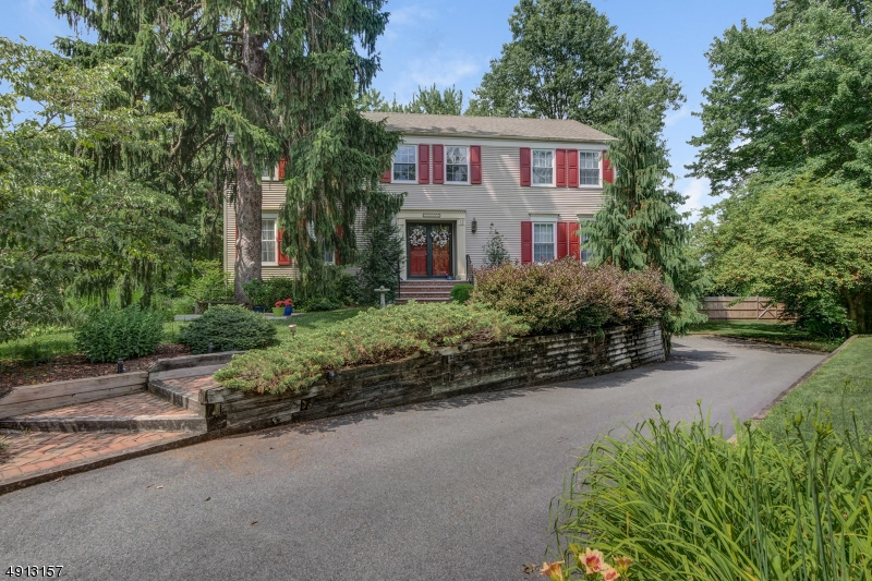 Amazing value in Washington's Headquarters! Charming four bedroom colonial less than one mile from the Morristown Train Station. Renovated kitchen and baths with many recent updates by current owner. Located in an area of town ideal for commuting, this home is located in one of Morristown's most desirable neighborhoods. Updated eat-in kitchen with Corian counter tops & stainless steel dishwasher, stove & microwave oven, family room with wood burning fireplace, built-ins & slider out to deck. Hardwood floors located on most of the 1st & 2nd floors.  Spacious master bedroom with new bath with large stall shower, double vanity & walk-in closet. Partially finished lower level perfect for crafts or home office. Beautifully landscaped on the end of a cul-de-sac street. Sidewalks provide easy access to town & train.