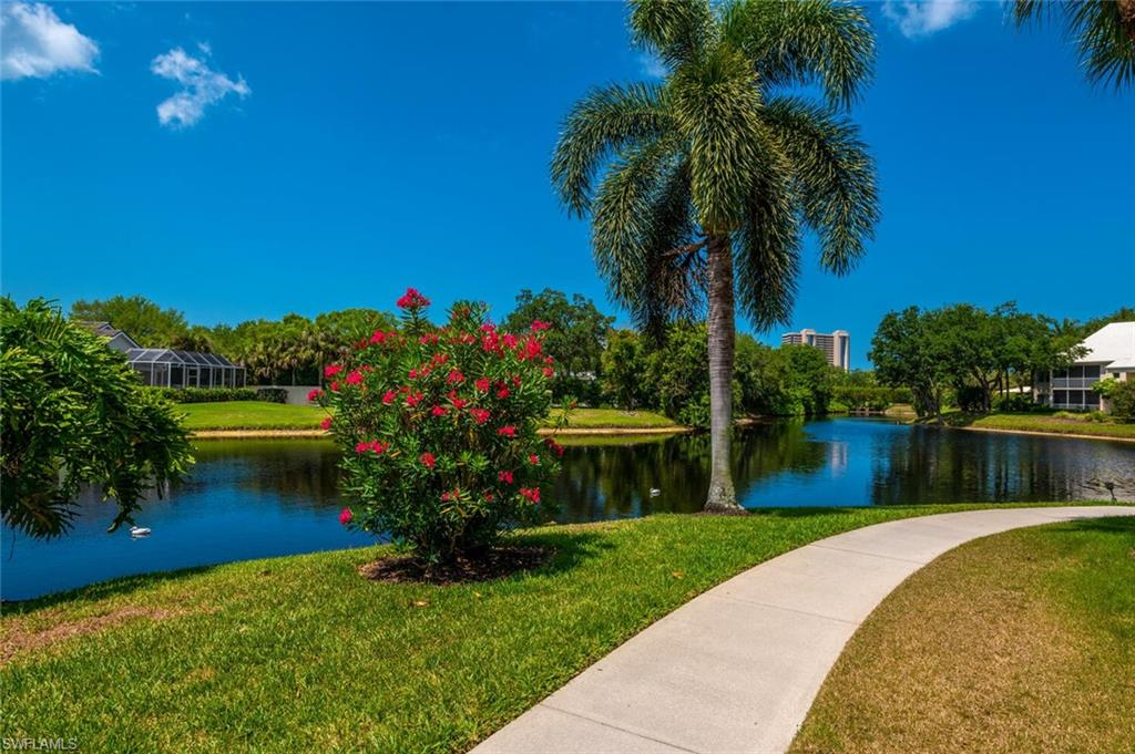 JUST LISTED in Willow Brook at Pelican Bay. 2nd floor 2 Bedroom+Den/2 Bath end unit with mesmerizing southern and western exposure lake views overlooking the neighboring St. Andrews community. Plantation shutters throughout with crown molding in the primary bedroom and den. Tasteful new turnkey furnishings in 2019, A/C system in 2018 and water heater in 2014. Reserved carport parking nearby and just steps from the community pool and clubhouse. Willow Brook offers significant Price/SF value to full-time residents, snowbirds and investors and is a pet-friendly Pelican Bay community. The movable exterior sliders in the sun room afford a perfect setting for your morning coffee and for entertaining friends while experiencing those picture postcard Naples sunsets. Compare and contrast the unique value proposition and unparalleled views of this condo with anything else currently on the market in Pelican Bay. Pelican Bay is an amenity-rich community situated west of Tamiami Trail North known for its miles of immaculate beach, coastal mangrove forests and breathtaking nature paths, Pelican Bay is Naples' premier mixed-use beachfront community!