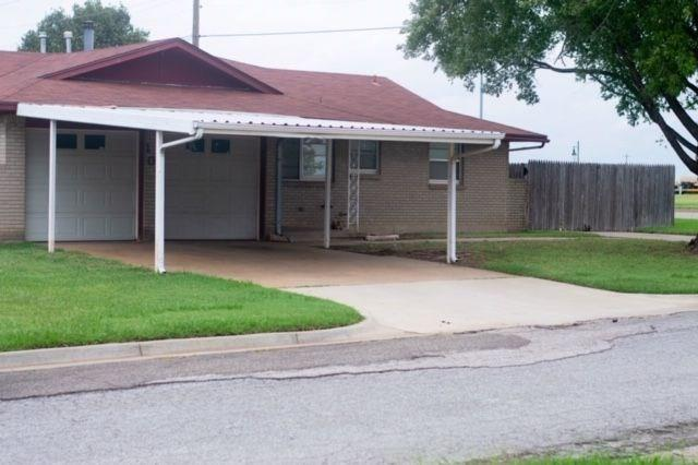Great home in Moore schools!Corner Lot..directly across from the Station Park, walking trails!  4 bedrooms, 2bath, 2 living areas, Carpet in bedrooms only, 2nd living room has a brick fireplace with french doors leading to the backyard!  Fenced yard with two drive ways!  2 car garage with double carport!