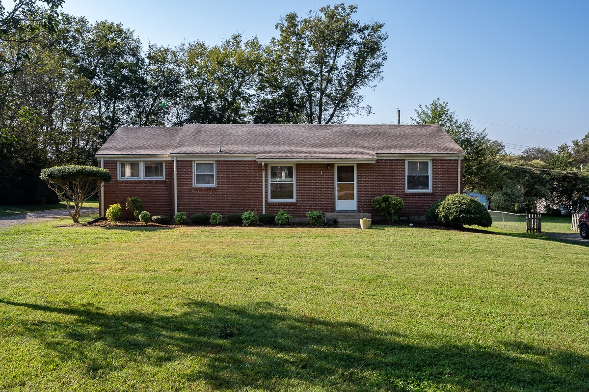 One level brick home located in the perfect location! This home features and open floor plan, NEW ROOF, updated Kitchen w/ stainless steel appliances, master bedroom w/ walk in closet and bathroom, spacious laundry room, nice size yard with large storage shed/workshop that has electric, and more!