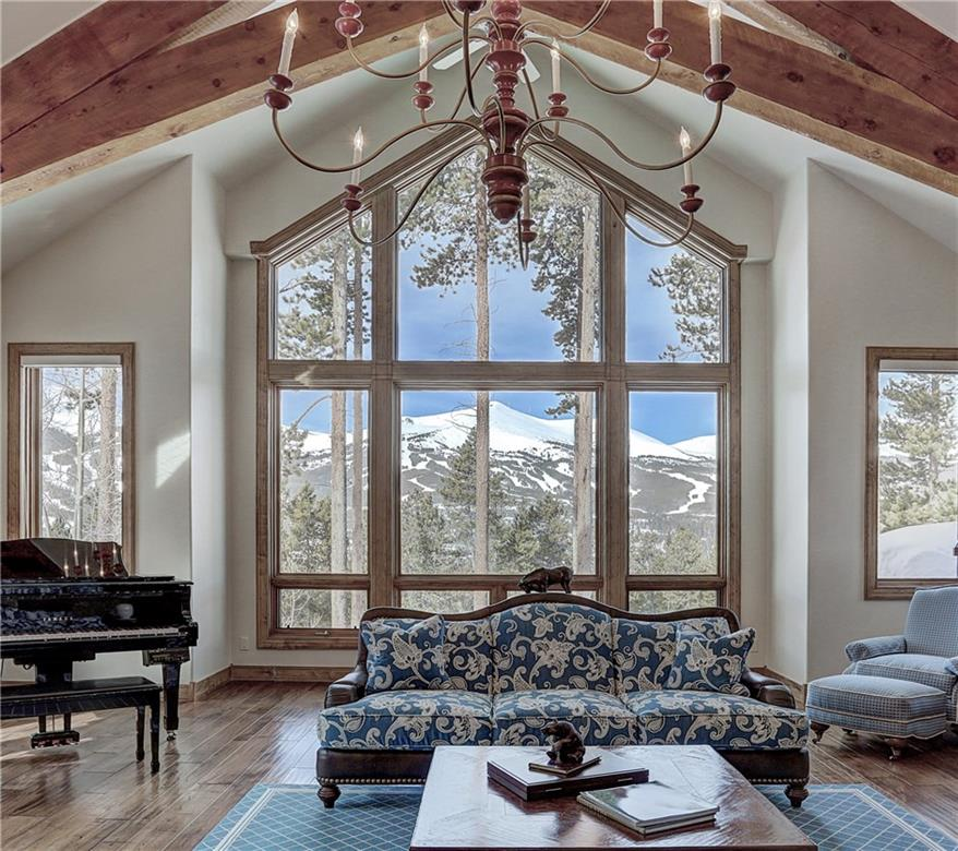 Located in the heart of Breckenridge, this beautifully appointed home has room for everyone. Walk to town or explore popular Carter Park, steps away. This grand home features upscale finishes & 6 en-suite bedrooms. Two living areas are connected by a gourmet kitchen with ample seating and Wolf appliances. Soak in the views from the spacious patio & private hot tub. Additional benefits include steam showers, a 3-car heated garage, established landscaping and abundant sunlight from dawn to sunset.