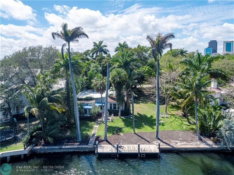 This is the property everyone has been waiting for, The Swanson Home, situated on one of Fort Lauderdale's most prestigious streets. Built in 1923 (not historically designated), this property has been in the same family since 1949. Located on the New River at the Tarpon Bend, this unique property features long water views and is prime for redevelopment. The existing home can be torn down to make way for your new dream home, there is 100' of water frontage on a 13,457 sf lot.