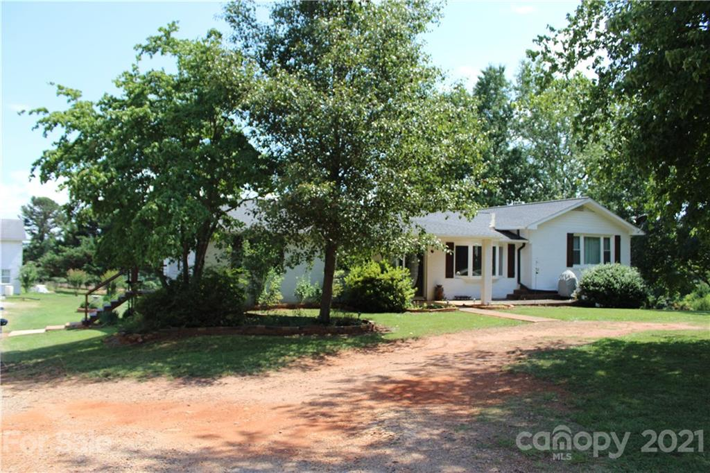 """An established """"Farmette"""" - mini farm - for sale in Polk County - just a few miles away from I-26, Landrum, Tryon & TIEC. The Property features a 2500+ square foot home, a large 40x60' Workshop with office space/ studio, fenced pastures, gardens, & a barn!  The main floor of the home has been completely updated with today's sought after finishes, wood/Lam floors, tiled bathrooms, & a large open kitchen perfect for family gatherings! Large Deck off the back overlooks the farm & workshop. The mostly finished downstairs consists of another kitchen, living room w/ fireplace, full bath, & an extra room. The patio leads you out to the gardens. The large workshop is perfect for your hobbies, carpentry, mechanics, or for storing your """"toys"""" - big enough for an RV. The quintessential barn is perfect for livestock, chickens, cows, ponies, etc. and leads out into a fenced pasture.  This home shows great!! The property is very versatile & will accommodate almost any interest  you have!"""