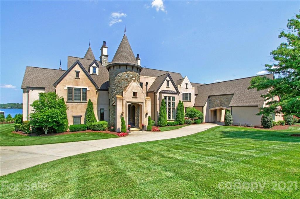 Stunning Waterfront European inspired estate home, gated entry & porte-cochere, exclusive Upper Jetton Road area.  Gently sloping lot with main floor walkout to pool and lake, the ultimate in lake living enjoyment.  Situated on .89 acres, the lake views are wide and the feel is private.  Exceptional craftmanship and superior attention to architectural detail.  Maple cabinetry, Chef's kitchen with Viking appliances and 2 islands. Inside elegance is matched only by the main channel views. Other amenities include a spiral staircase, library with sliding ladder, custom home theater, and a secret room!  Covered lakeside veranda, gas fireplace & pool level gas grill.  Entertain away -- or just curl up with a book and enjoy the pool and lake.  A fenced yard leads to a private pier and covered dock. The Guest / Pool house is not to be overlooked in either its existing beauty or its potential functionality as an upscale home office suite, with one bedroom, a full bath and a kitchenette.