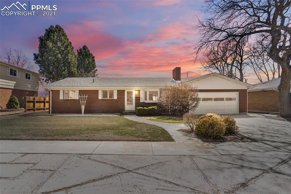 Welcome to this exceptionally well-maintained ranch-style home in Century Heights.  This well loved brick home with Pikes Peak views offers 5 bedrooms, 3 bathrooms, and a 2 car attached garage.  The main level offers original hardwood flooring that has been preserved under carpeting and is waiting to meet you.  Perfectly located in the center of town and near all amenities and only a 10 minute walk to the Palmer Park trail-head.  The main level offers 3 bedrooms, a formal living, dining, kitchen, and spacious family room featuring a wall of windows and a slider out to the covered back patio.  From the back patio step into your enclosed sunroom to enjoy the outdoors and mountain views year round.  You can also utilize the sunroom as a spa-tub room or greenhouse.  The large finished basement includes 2 bedrooms, 2nd family room, and a massive laundry/utility/work space.  The fully-fenced rear yard offers Pikes Peak views, hard-to-find alley access and a storage shed.  Come see this incredible charmer today!