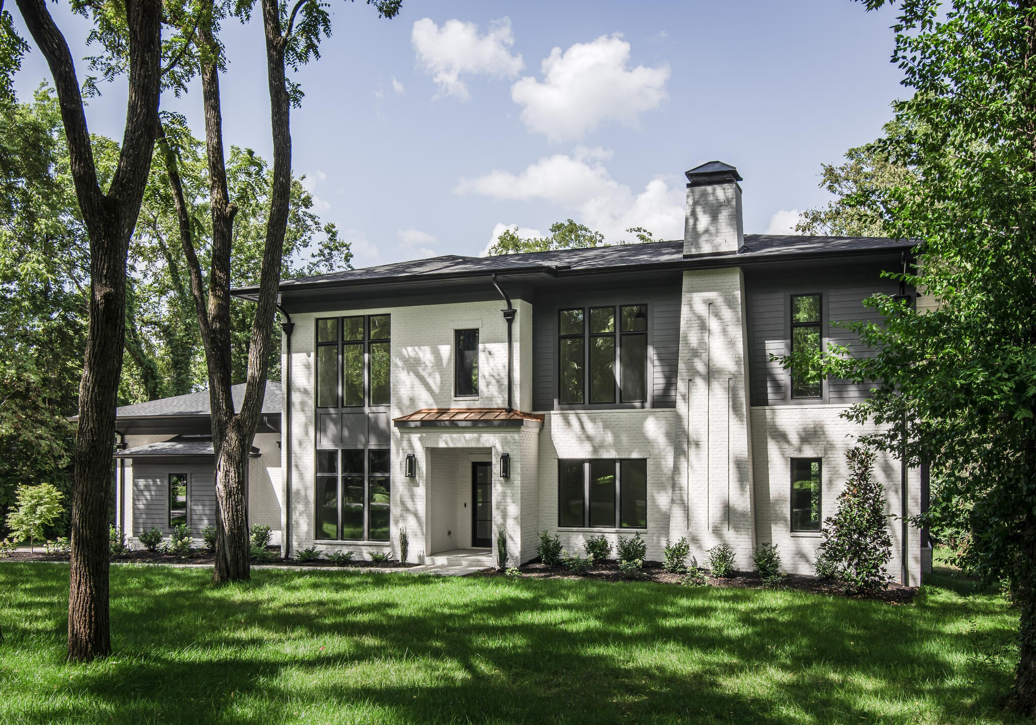 Contemporary design in Belle Meade Highlands! This gorgeous new construction home has 2 bedrooms on the main floor, luxury finishes and 3 car garage on an over half acre lot w/ room for a pool! P.Shea Design & Province Builders home that offers all the bells & whistles while maintaining understated elegance.  Don't miss this!