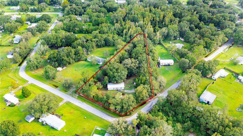 Perfect for INVESTORS or First time home buyer!! This 3 bedroom 2 bath home sits on 1.21 acres in Prime location of Wesley Chapel.  Plenty of space for all your toys. No flood insurance required.