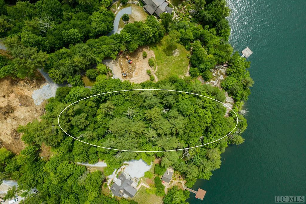 Wonderful building lot with breathtaking lake and mountain views just off the shoreline of beautiful Lake Glenville.  This large 1.1 acre lot located in prestigious Lakeside Village is only a short drive to the Cashiers Crossroads and the surrounding gourmet restaurants and boutique shops.  Lake Glenville has approximately 26 miles of shoreline and is the highest elevated lake east of the Mississippi.