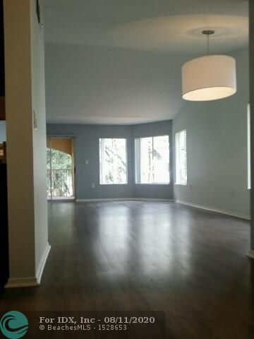 """DIRECT LAKE VIEWS FROM 5 LARGE WINDOWS & HUGE BALCONY***RARELY AVAILABLE TOP 2ND FLOOR END UNIT CORNER***LOFTY VOLUME CEILINGS ***TOTALLY PRIVATE, EXCLUSIVE STAIRCASE JUST FOR THIS UNIT. Windows on 3 sides. BEST 2/2 in Entire Community. Updated, Spotless & Clean, w/Granite & Stainless Kitchen. Split bed plan. Washer/Dryer in unit, 2 full baths, 4 WALK-IN CLOSETS, Grand waterfront pool, gym, club house, Tennis Court & 2 Gated card access community Entrances. Security Patrolled,""""Sailboat Pointe"""" is a Certified Wildlife Habitat Community, available Sept 1st. 5 minutes to Wilton Drive, less than 10 to the Beach. Assigned Parking spot right in front of your Home. On site managers Office. Florida living at it's finest!"""