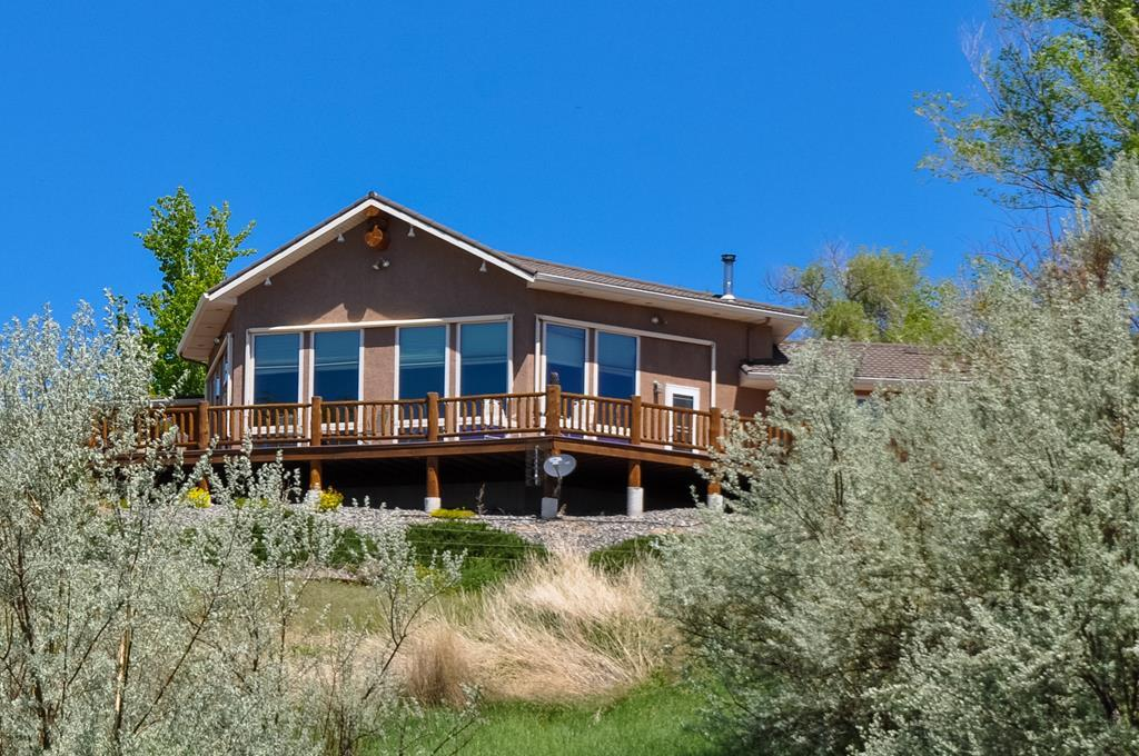 Located on 1/3 miles of the historic Shoshone River this wildlife mecca has so much to offer. Income property, fishing, 3 ponds, hunting, shops, outbuilding, riding arena, and pasture.. The main residence is a high end custom built home boasting Northwest Wyoming flare.  This type of property is very hard to find, the kind of property that stays in families for generations. Must see!
