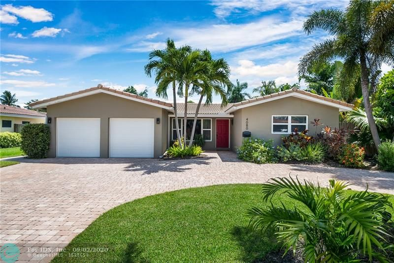 Welcoming Coral Heights pool home with everything desired for a comfortable South Florida lifestyle.  Circular pavered drive with parking for multiple (5+) vehicles plus a huge two car garage approximately 20 feet wide and almost 28 feet deep for excellent boat/watercraft storage options.  Living/dining area plus a separate family room, kitchen with stainless steel appliances and granite counters, adjacent laundry room with pantry space, impact windows/doors and more.  Lush tropical landscaping and a fenced back yard offers privacy and presents the perfect pool setting.  Multiple ways to enjoy the outdoors with barbecuing, covered dining, relaxing, grass for pets, etc., and outside accessed storage for lawn, grilling and pool equipment.