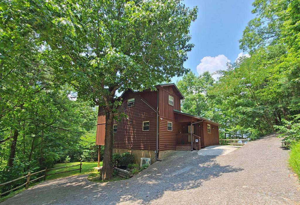 3 CABINS less then 5 minutes away from the Main Parkway in Pigeon Forge on 2.62 acres! MAIN CABINS (#868)  is ~ 2216 sq.ft, cabin # 2 ~ 1070 sq.ft + 2car garage in the basement, cabin #3 ~540 sq.ft. MAIN CABIN is rented nightly as a 3 BEDROOM CABIN. Cabin grossed 53K in 2019, on track to gross close to 60K in 2021. In 2020 cabin was taken off rentals due to covid for several months and grossed 39k. Main Cabin features an open floor plan with bedroom and bathroom on the main floor, bonus is room is currently used as a bedroom as well, utility room. Upstairs you will find a spacious MASTER SUITE. Finished basement has a game room/tv room + ANOTHER BONUS ROOM currently used as owners closet. BEAUTIFUL LEVEL BACK YARD, and DOWNTOWN PIGEON FORGE VIEWS from back deck and pick-nick area.  CABIN#866 is a 1 BEDROOM +LOFT, 1.5 Bath home with a 2 CAR GARAGE IN THE BASEMENT. Cabin needs updating hence is being sold AS IS. Cabin was winter views of Downtown Pigeon Forge. CABIN #860 is adorable 1 bedroom cabin with winter MOUNT LE CONTE VIEWS Cabin has a tall crawlspace with outside entrance. Main cabin#868 has 2 bedroom septic permit, cabin #860 has 1 br septic permit, cabin# 866 also has 1 bedroom septic. All 3 cabins share a well. Each cabin has a WOOD BURNING FIREPLACE. MAIN CABIN HAS BEEN RENOVED: NEW METAL ROOF in 2013, NEW APPLIANCES in 2017, 2 NEW HVAC in 2017, new furniture etc. in 2017. CABIN #866 has a NEW METAL ROOF ( 2019) and new HVAC (2015). CABIN #860 - NEW METAL ROOF in 2015. Concrete driveway installed in 2015.