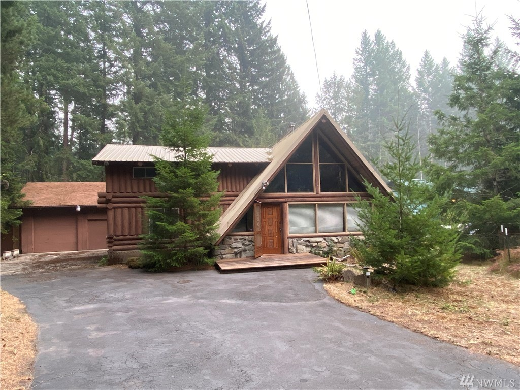 Spacious custom log cabin in Packwood WA. Close to HOA amenities such as pool, golf, clubhouse. 30 minutes to White Pass skiing & Mt Rainier National Park. 2 1/2 hours to SEA & PDX. Access to National Forest and hiking trails right around the corner. This property features 2 Bedrooms + bonus room, 1.75 bath, deck space, large detached garage with shop area, RV carport, fireplace. New pex plumbing throughout home.