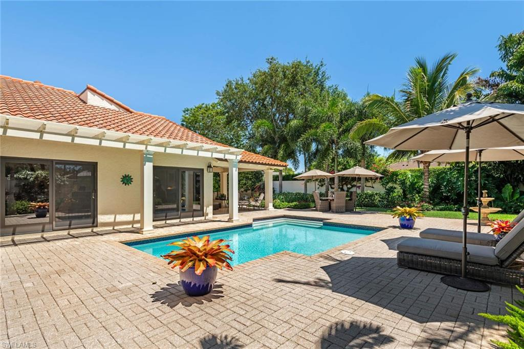 View this pristine, custom 2+den villa that lives like a single family home located in the premier community of Las Brisas! A private, larger end unit lot boast a tranquil space bordered by lush trees and shrubs professional designed, new lanai with Travertine deck, pergola and refreshing salt water pool which was refinished in 2017. Outdoor furniture included with home. Once inside, you will be greeted by the custom open floor plan drenched in sunlight by the newly installed skylights. Significant updates to this home include Cambria Quartz countertops, stone backsplash, cabinets, Bosch & Subzero appliances, travertine flooring, custom closets, Anderson Impact Windows & Sliders, Hunter Douglas shades & blinds and newer hot water heater (2017). See list for all renovations.  The Pelican Bay community includes tram service with exclusive access to private beaches in Naples along with 2 restaurants. Enjoy the amenities of 2 tennis centers, a first-class attended fitness center, walking and bike paths, canoes and kayaks.