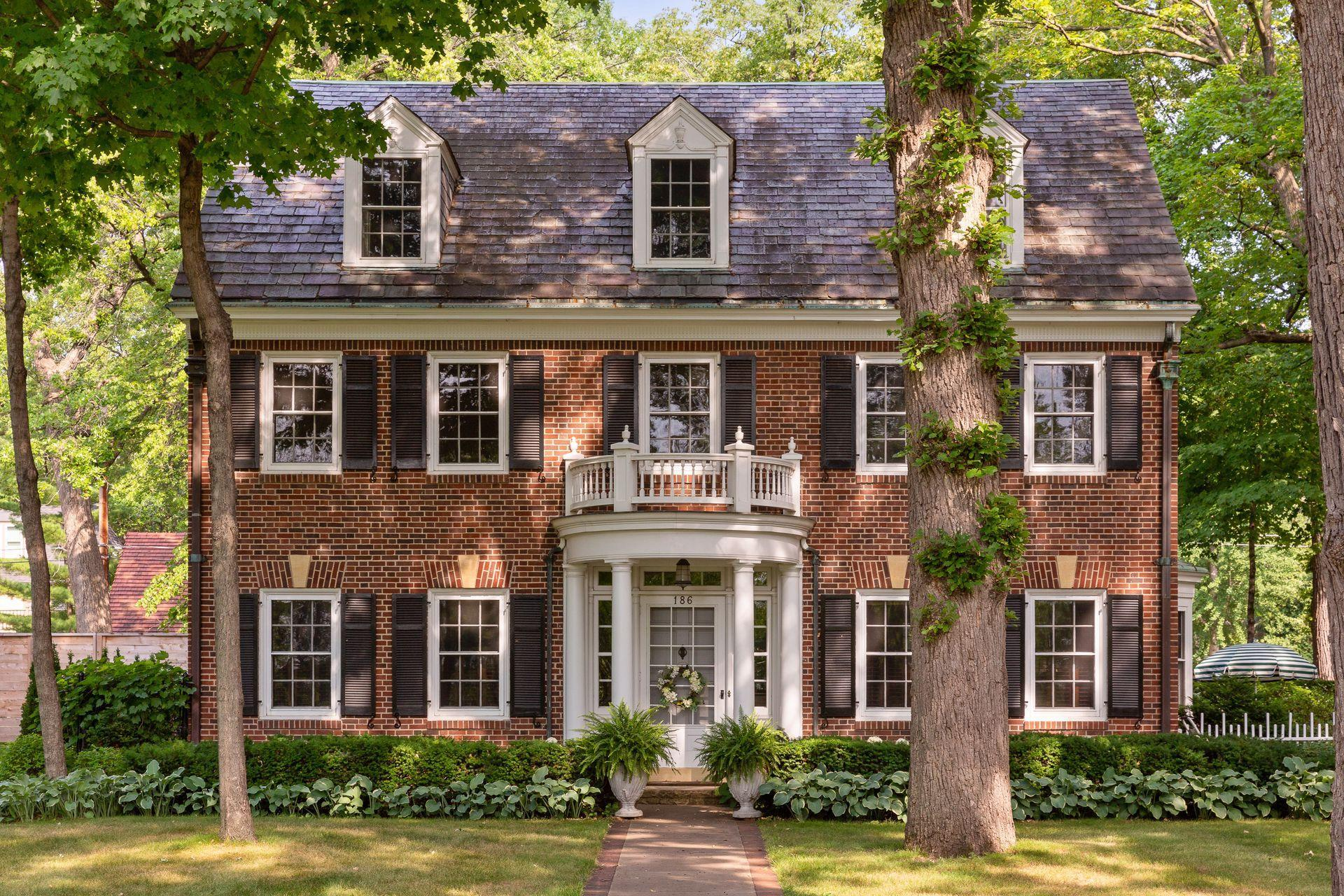 Welcome to this spectacular all-brick Georgian Revival on Mississippi River Boulevard, nestled among mature trees in an incredible setting with breathtaking panoramic views!