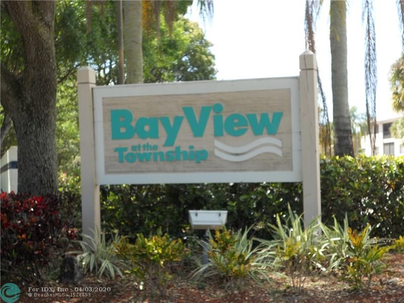 Best view in BAYVIEW!  Spacious 3/2 condo on the 3rd floor. NO AGE RESTRICTIONS.  Breezeway/Garden entry with elevator.  Split floorplan, full size laundry room, eat in kitchen.  3rd bedroom can be used for office/den. Screened balcony with a fabulous view of the lake and pool.  Fish from your backyard!  Accordion shutters for hurricane protection. A/C and water heater approx. 5 years old.  Plenty of Guest parking.  1 Assigned spot. Bayview at the Township offers its own pool and car wash area. Owners enjoy all the Township Recreation complex has to offer with Clubhouse, Gym, Theater, Basketball, Library, Pool, Racquetball, Pickleball and much more! Association requires minimum 650 credit score with 10% down. No leasing. No pets. Located near Turnpike and Sample. Easy access to MIA or PBI.