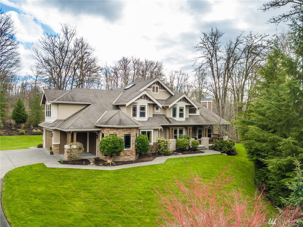 Enjoy peace & tranquility in this beautiful craftsman style home recently updated & upgraded in a quiet cul-de-sac. Tall ceilings, side load 3 car grg w/storage, wrap around covr'd deck, new lighting t/o, refinished maple hrdwds, new study w/built-in 2-person desk, exquisite master bath w/heated wood grain tile flrs, free standing tub, lrg walk-in closet. 2 bdrms share Jack & Jill, 4th has adj full bth. Central AC, 2 new high efficiency furnaces w/Hepa filters. No HOA & Lake Washington schools!