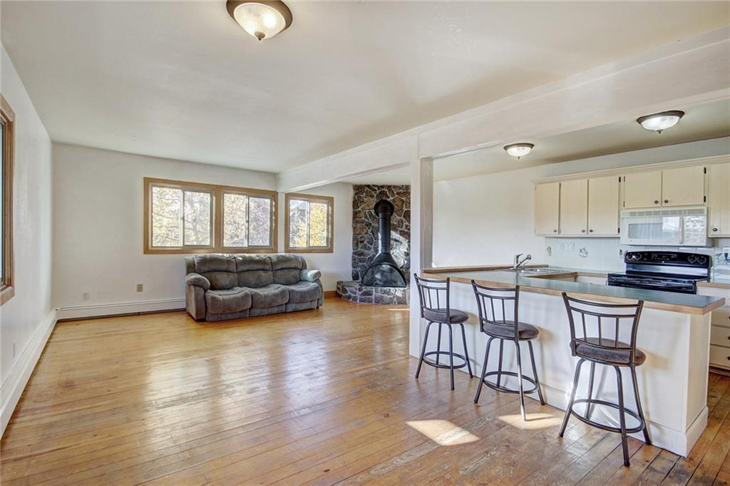 Enjoy a cozy wood fire & entertain in this open living area and spacious kitchen.