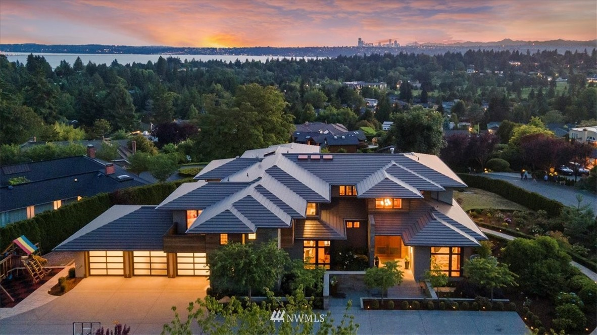 With sweeping view at all 3 levels and modern design, this unparalleled home is a rare found even in Clyde Hill. Paired with show stopping views of LW and Seattle from every window, it create a flawless home for artful living. Proudly designed by Loveless, Eiffert & Anderson and built by Bender Chaffey. Exquisite details, beautiful craftsmanship. C-thru fireplaces add romantic taste to the winter twilights. Gourmet kitchen with huge island and caterer's pantry behind it is ready for big parties. Covered, heated deck. Guest suite on main. Master and 3 other guest suites upstairs. Master with private deck is exposed to incredible views and sunlight. Lake view even in basement which features rec, wine cellar, gym, media room. Call it home!