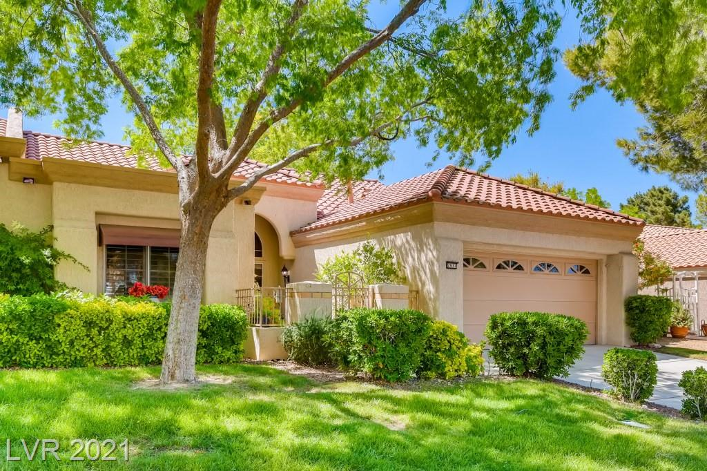 """REDUCED $50,000 -- WOW!!  LIVE ON GRASSY GREENBELT WITH VIEWS OF GOLF COURSE, MOUNTAINS & LAKE W/ WATER FEATURE TOO!! NO GOLF BALLS! ENJOY SUN CITY LIVING AS YOU RELAX & SOAK IN THE VIEWS ON YOUR LARGE TREE-SHADED PATIO IN THIS WELL CARED TOWNHOME! WELCOMING TILED GATED ENTRY COURTYARD -- BACK PATIO ALSO TILED & EVEN HAS SOLAR ROLL DOWN SCREENS. GORGEOUS SHUTTERS OR UPGRADED BLINDS 0N WINDOWS & BOTH SLIDING DOORS TO PATIO.  14"""" TILE AT ENTRY, BOTH BATHS & KITCHEN --  CARPET ONLY 2 YEARS OLD! KITCHEN HAS GORGEOUS CORIAN COUNTERS, CABINETS WITH PULL-OUTS, STAINLESS STEEL APPLIANCES & EXTENDED GARDEN WINDOW. DELIGHTFUL 2-SIDED GAS FIREPLACE BETWEEN LIVING ROOM AND FAMILY ROOM TO ENJOY THOSE COZY EVENINGS! VAULTED CEILINGS WITH NEWER UPSCALE CEILING FANS WITH LIGHTS IN LIVING/DINING ROOM, FAMILY NEVADA ROOM AND MASTER BEDROOM. GARAGE WITH 13 SEER HVAC SYSTEM (ABOUT 9 YEARS OLD), NEWER WATER HEATER WITH PAN & STRAPS, WALL OF UPSCALE BUILT-IN STORAGE CABINETS, SIDE DOOR & GOLF CART PARKING!"""