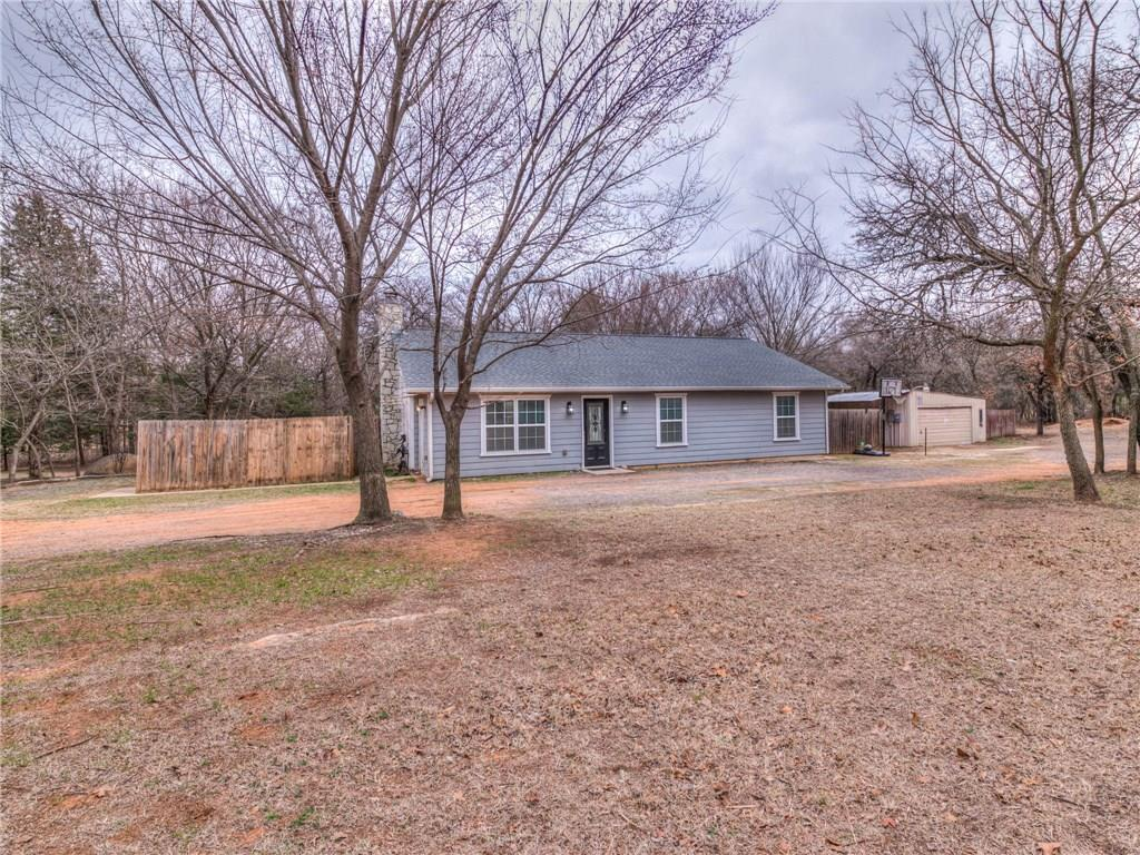 Location, Location, Location!  Two Beautifully Wooded Acres in Edmond East of I-35 close to Lake Arcadia!  Private lot with tons of trees, including fruit trees. Huge 38'x22' Shop with two garage lifts plus a 38'x12' metal covering.  In 2012 308 sq ft was added to property, permit pulled.  Updated kitchen with granite and stainless steel appliances.  Fireplace in living can heat entire home.  Master bedroom has en suite bath.  Laundry room is inside of home.  Huge back deck off of kitchen that leads to above ground pool.  In-ground storm shelter.  On private well with septic tank.  Windows at front of property replaced in 2012 and are low E.  Attic has double lay of insulation, blown eco friendly and radiant barrier.  Avg utility bills are $125/month.  Property is perfect for Cash or possible Conventional Loan Buyer, won't go FHA or VA, and for new owner to finish updates and make it their Own!  Welcome to your Home in the Woods!  Seller is selling property As-Is.