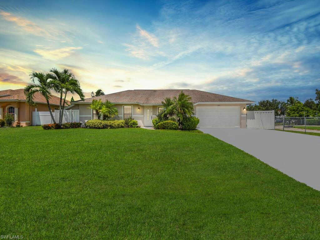 Charming pool home situated on a DOUBLE LOT with a peaceful water view and private boat ramp.  This move-in ready 3 bedroom residence is conveniently located close to Santa Barbara Boulevard, restaurants, schools, stores and is easily accessible to I-75.  The home boasts light kitchen cabinetry, built-in breakfast nook, spacious pool deck, screened lanai and fenced-in backyard.  Come enjoy the Florida lifestyle where you can fish, ski, boat, cool off in the pool, relax in the hot tub and entertain on the outside deck while taking in the scenic view of the water.