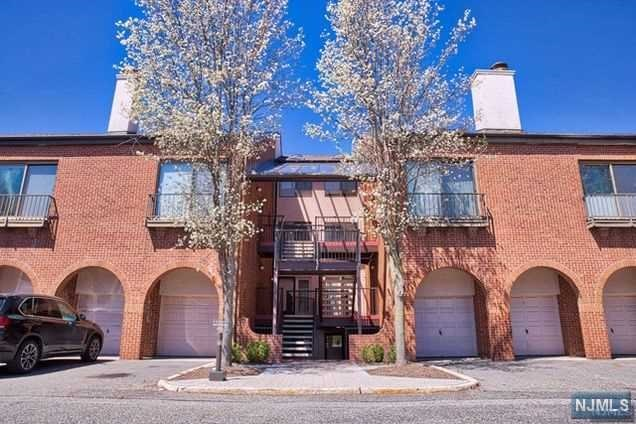 Welcome to this 2 Bedroom, 1.5 bath luxury townhouse community.   The community offers a convenient lifestyle with 24 hour gated security, outdoor pool, tennis court and close access to all highways and NYC bus transportation.   The condo features an entry foyer, modern kitchen, dining area and a Living room and fireplace plus powder room.   Enjoy morning coffee on the balcony or an evening glass of wine.  The second floor features a master bedroom with two closets plus a balcony.  A full bath with convenient  laundry and a second bedroom with a deep closet complete the second floor.   Welcome home
