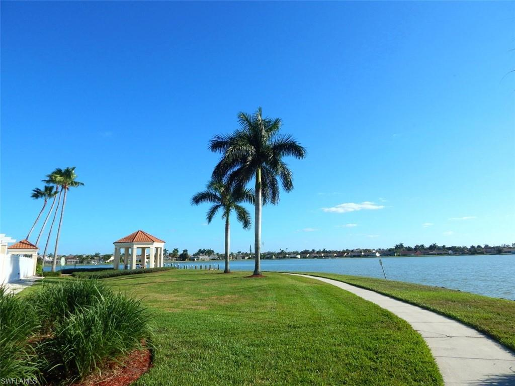 Newly remodeled - awesome Lake view - great Location in North Naples! There is Nothing you will miss! This condo came on the market just in time to escape the cold winter up North to enjoy living in paradise. You will find a freshly remodeled condo in a non gated community close to shopping, dining and only 10 Minutes to the beach! You can choose between two pools, one is located in the subdivision and one at the Clubhouse at the lake where you also will find the tennis courts and the exercise room. Enjoy your morning coffee when the sun rises sitting on your screened balcony. The unit comes with all new appliances, including new washer and dryer. It was completely fresh painted and the brand new kitchen has a quartz countertop and glass backslash. And finally new contemporary laminate flooring in the bedrooms and the living-room, dining-room area. A must-see and want-have. Can life be any better? Call us for more information.