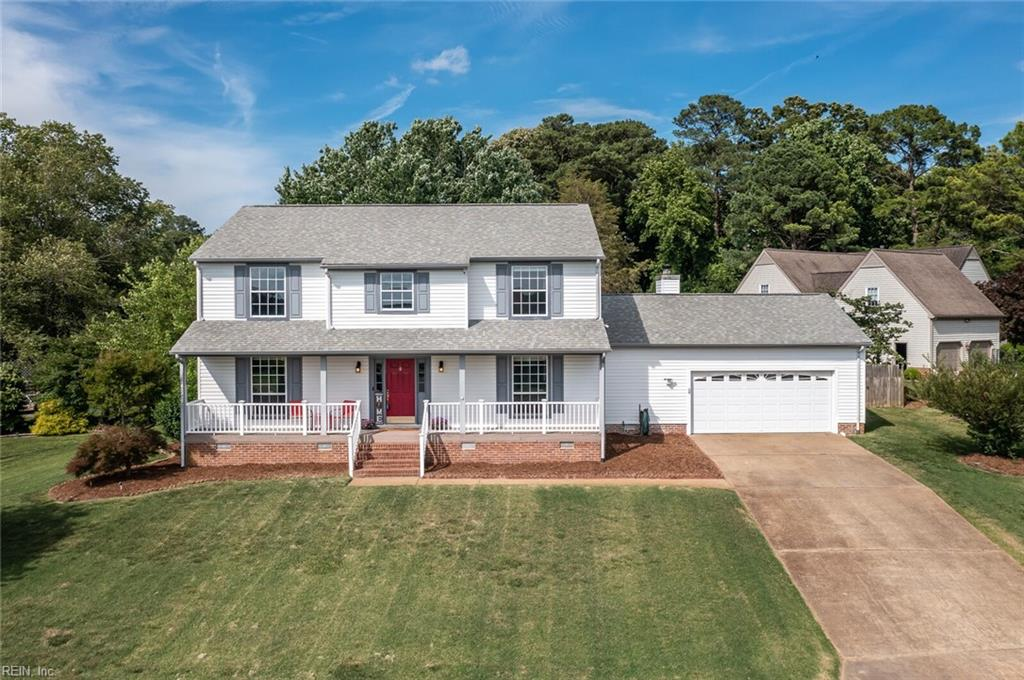 This beautiful home sits at the end of a cul-de-sac, with a gorgeous view of the James River from the front porch. As you enter off the spacious, columned front porch, you are greeted with bright, natural light and a large foyer. A first floor bedroom is off to the right with an ensuite and lots of space. The kitchen and great room have been totally updated with a modern farmhouse style that looks right out of a magazine complete with a wood burning fireplace, an open-style butler's pantry, shiplap, faux exposed beams, hexagon tile backsplash, a farmhouse sink in the center island, industrial style open shelving, stainless steel appliances, and tons of cabinet space. Off the kitchen is a formal dining room, connected to the front sitting room, large enough to be a second living area featuring wainscoting along the walls. Upstairs you will find four large, carpeted bedrooms including the primary with an ensuite and walk in closet. The screened deck opens to a generous, fenced backyard.
