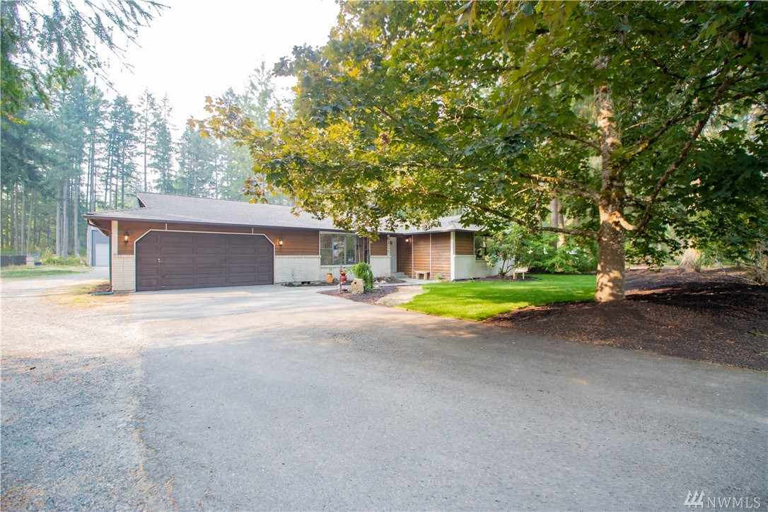 Beautifully updated rambler in the sought after Indian Springs neighborhood! Open floor plan with nearly 1,500 square feet, 3 oversized bedrooms and 2 full baths. New paint and floors throughout. French doors lead to a mostly-finished 600sf heated garage. Beautiful 1.15 acres with privacy and fruit trees, ready for all of your hobbies. Car enthusiasts dream shop measuring 36Wx48Dx16H with RV parking. Loafing shed with stall opens out to a fully fenced roaming area. Best of all worlds and no HOA!