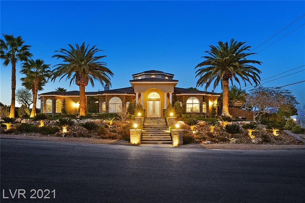 Custom single-story estate on a private one-acre lot with no HOA.  Tremendous amounts of curb-appeal with formal turret entry & lush landscaping. Incredible foyer sets the tone for the elegant home with wood beamed ceiling & polished travertine flooring.  Spacious open floor plan offers formal living & dining. The gourmet kitchen features custom cabinetry, a central island with cooktop, & a curved elevated bar with granite counters. Natural stone accent walls throughout. Copious primary suite features a separate sitting room, gas fireplace, & luxurious bath with walk-in shower, elevated tub, dual vanities, & separate make-up area.  Finished outdoor space is an entertainer's dream.  It features a covered sitting area, voluminous outdoor kitchen with multiple barbecue grills, cooktop, refrigerator, & dishwasher.  Lush landscaping & natural stone decking surround an expansive pool & spa. A detached casita with a full bath, 3 car attached garage, & detached RV garage with half bath.
