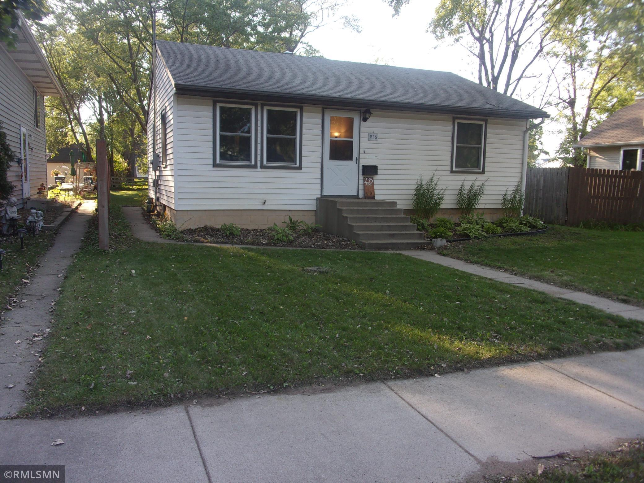 Rambler with many updates including newer vinyl siding, clad windows, egress window in basement. updated kitchen with new appliances. newer doors, siding, aluminum soffits, central air, furnace, water heater, breakers, painted basement walls. basement bath stool is in place and vanity is there but not installed.  sill room to build equity with adding a garage or finishing the basement.