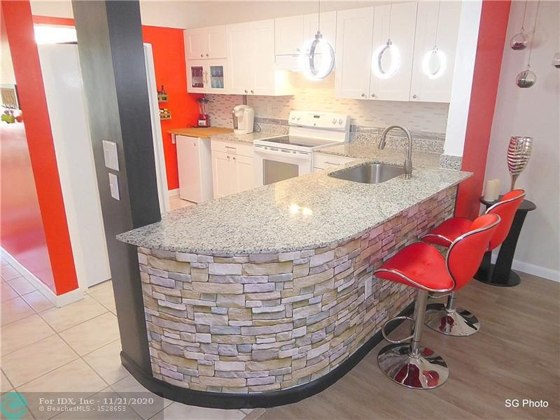 WOW! ABSOLUTELY SPLENDID & SPACIOUS (1260 pi2) GROUND FLOOR SPLIT BEDROOM 2/2 CONDO WITH MODERN OPEN KITCHEN IN GATED 55+ COMMUNITY! COMPLETELY RENOVATED, FULLY NICELY FURNISHED & TURNKEY (EVERYTHING STAY, INCLUDING ELECTRONICS!) AND TASTEFULLY DECORATED!* WASHER AND DRYER IN UNIT* OPEN KITCHEN WITH GRANITE COUNTERTOP,  NEW APPLIANCES, GLASS BACKSPLASH AND PENDANTS LIGHTS* ALL TILE & LAMINATE FLOORS* DECORATIVE FIREPLACE* TANKLESS WATER-HEATER* 2 WALK-IN CLOSETS* EXTRA-STORAGE* CONVENIENT SCREENED PATIO JUST FEW STEPS FROM POOL WITH GAZEBO AREA AND A HEAVENLY GOLF COURSE* FRIENDLY COMMUNITY WITH 24/7 MANNED SECURITY GATE, CLUBHOUSE, ALL AMENITIES & SOCIAL ACTIVITIES* ASSOCIATION REQUIRES CREDIT SCORE >710 AND 45K INCOME* BRING YOUR FUSSIEST BUYERS, THIS ONE WILL NOT DISAPPOINT! MUST SEE!
